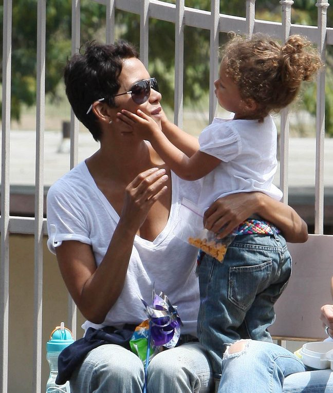Halle Berry, White blouse, denim capris, brown sandals, sunglasses
